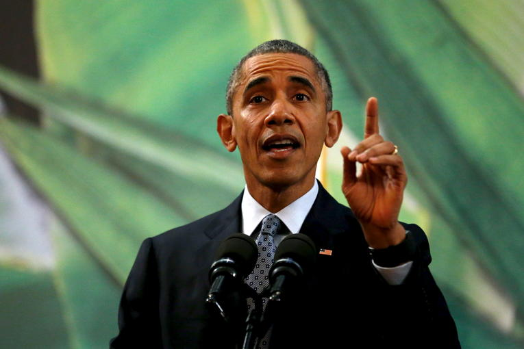 U.S. President Barack Obama gestures while reacting to a question about U.S. politicians opposed to taking in Syrian refugees as he delivers remarks after meeting with the Philippines President Benigno Aquino alongside the APEC summit in Manila, Philippines, November 18, 2015. REUTERS/Jonathan Ernst - RTS7NUH
